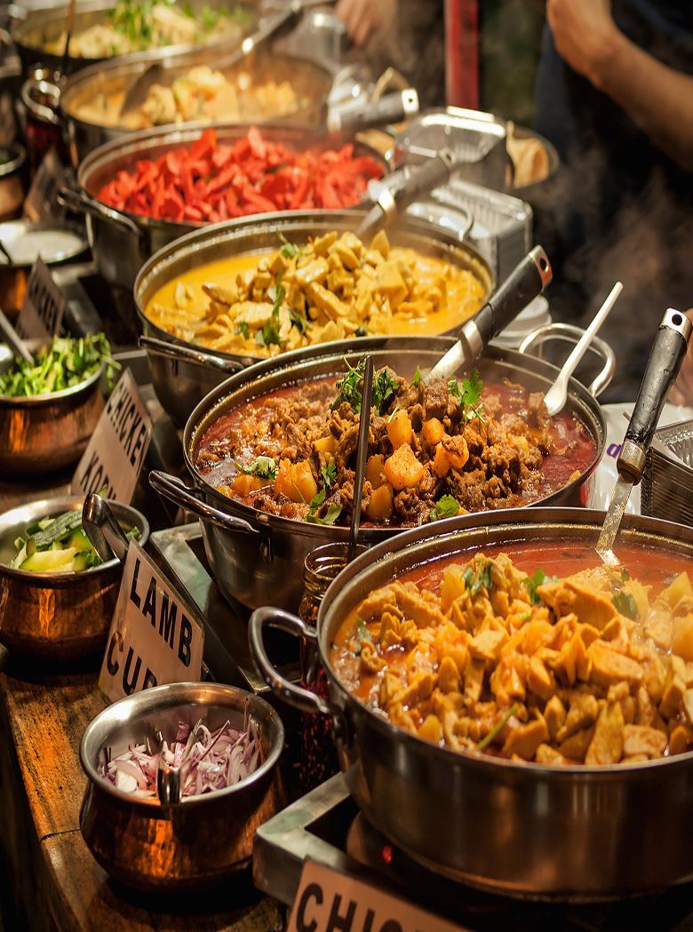 14577603 - oriental food - indian takeaway at a london s market